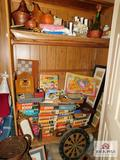 Contents of closet games, puzzels, decorative items