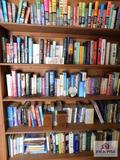 Contents of bookshelves: Nora Roberts, J>D> Robb, Iris Johansen