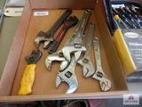 Flat of adjustable end wrenches