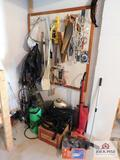 Contents of wall electric hedge trimmer, saws, sprayers, small vacuum