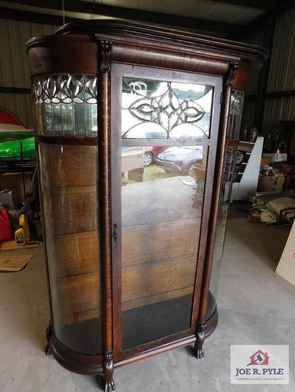 Antique curved glass china, claw feet, leaded glass feature (68 in. x44 in. x16 in.)