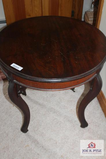 Old Style Table with Curved Legs and Wheels