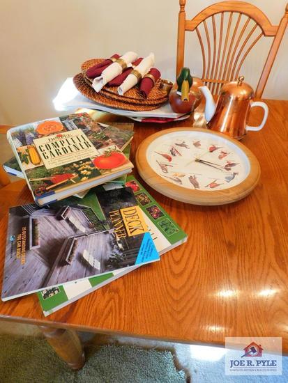 Gardening books, place mats, napkins, clock, teapot & hand painted decoy