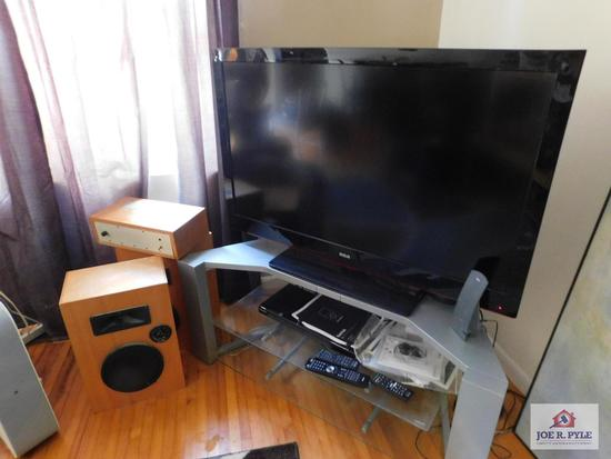"RCA 46"" flat screen TV with Sony DVD player, wood speakers & entertainment stand"