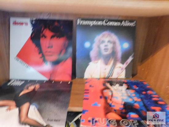 Book shelf and contents - assorted records Eagles, REO Speedwagon, Foreigner, Journey, Commodores,