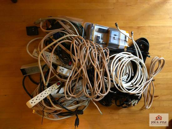 Assorted extension cords and power strips