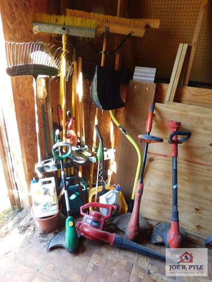 Lot of hand tools - electric weed eaters, brooms & car ramps