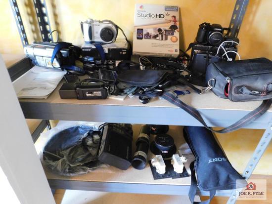 Contents of shelf - Sony video camera recorder, Sony Mavica camcorder, HandyCam, Pinnacle studio HD,