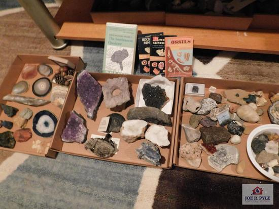 Collection of rocks, geodes and crystals with books