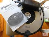 iRobot Roomba vacuum cleaning robot with charge cord