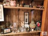 Contents of shelves collection of decorative items - candleholders, lamp, piggy banks, small clocks