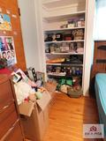 Contents of shelves and children's toys, puzzles and stuffed animals, collection of purses, curtain