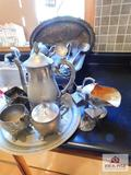 Collection of silver plate items - serving trays, pitchers, creamer & sugar, spoons & utensils