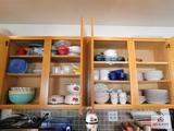 Contents of cabinets - collection of plates, bowls & mugs, mixing bowls, bakeware & Tupperware