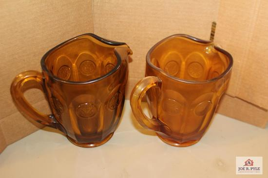 Vintage coin glass pitchers
