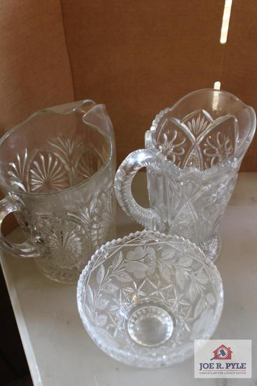 Pressed glass pitchers and bowl