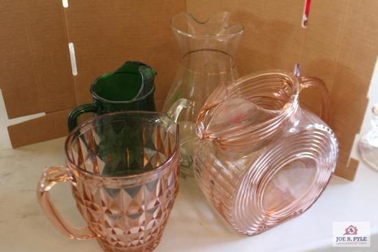 Depression glass pitchers