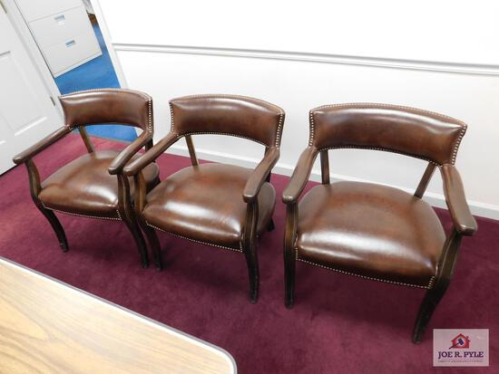 3 brown office chairs