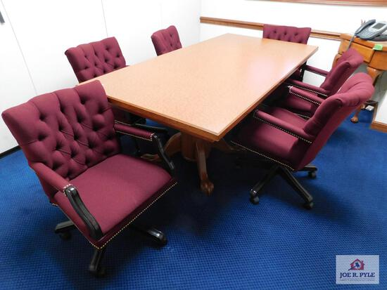 Rectangular conference table with 6 cloth chairs with rollers