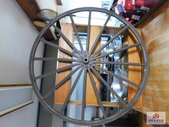 Metal rimmed wooden wagon wheel