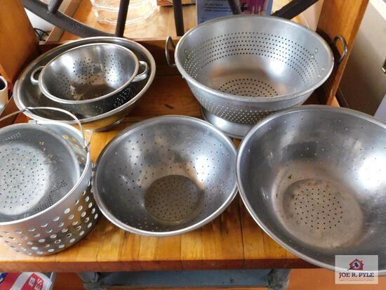 Collection of restaurant colanders