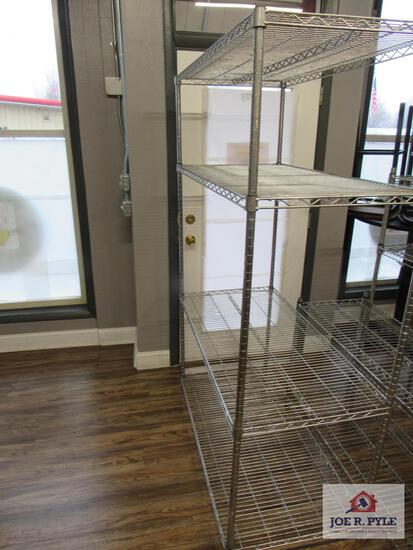 4 tier stainless steel shelves 4 ft wide approx.