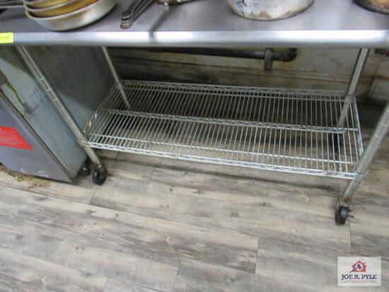 Stainless steel table 2 ft wide, 4 ft long, 36 inches tall