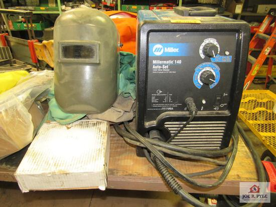 Miller 140 auto set welder with wire, helmet, and gloves