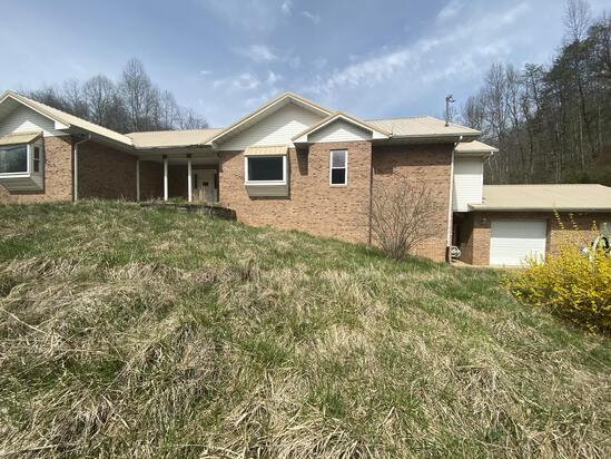 Brick Home on 19 Acres Sold to the Highest Bidder