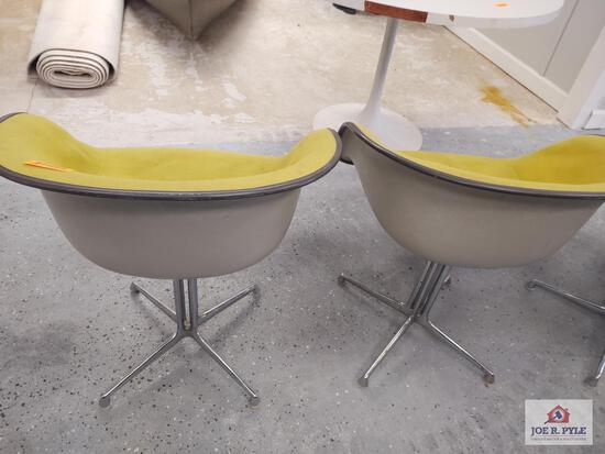 2 yellow Herman Miller chairs