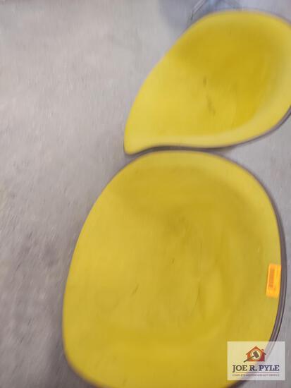 2 yellow Herman Miller chairs
