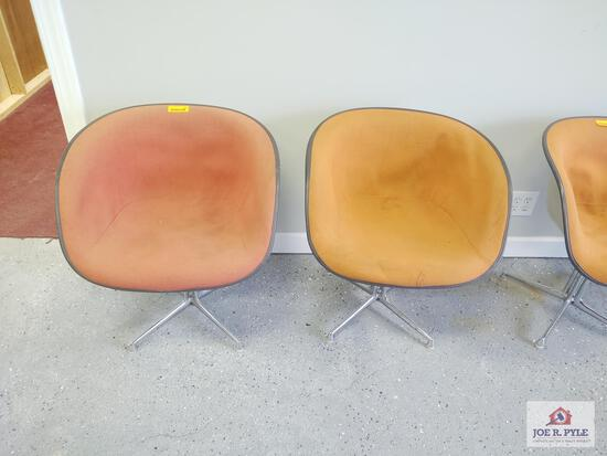 2 Orange Herman Miller chairs