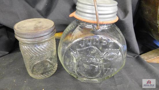 2 Jumbo peanut butter jars; larger jar Jumbo elephant trunk is up