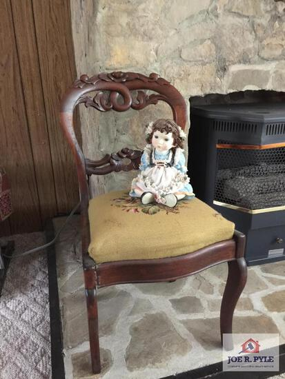 Antique chair and doll statue