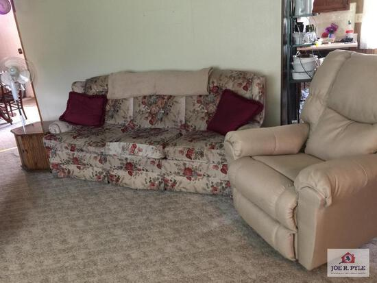 Modern sofa, end table, fan, and recliner