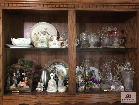 Contents of china cabinet: glass and decorator