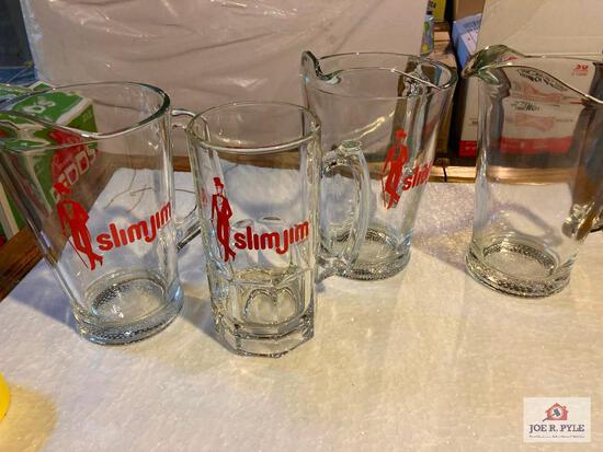 Four Slim Jim glass advertising pitchers