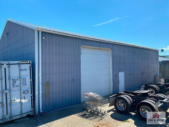 50x60 Metal building w/ 2 bay doors that measure 14x12