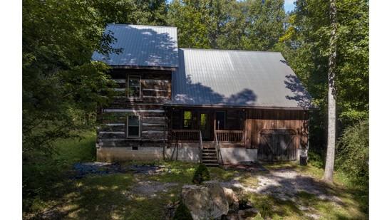 Unique Log Home on 5 Acres
