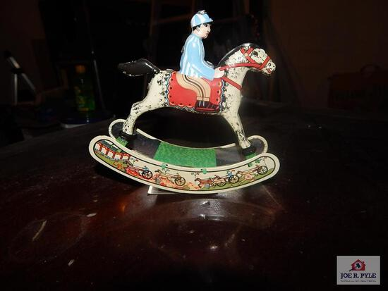 Tin windup jockey w/key