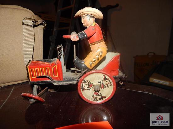 Tin windup cowboy on jalopy w/ key