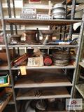 Contents of shelf to include small plastic tires, small rims, ? etc.