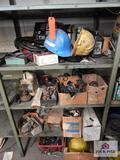 Contents of shelf to include Reese hitch balls, hard hats, wire, etc.