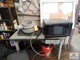 Lot of desk, chair, microwave, etc.