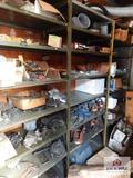 Contents of 4 shelves - PTO shaft, hydraulic pump, yokes, etc.