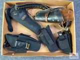 {145} Flat of holsters