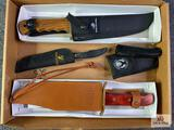 {133} Lot of (4) knives: (2) Whitetails commemorative knives, (1) Winchester NRA Bowie, (1) Legacy
