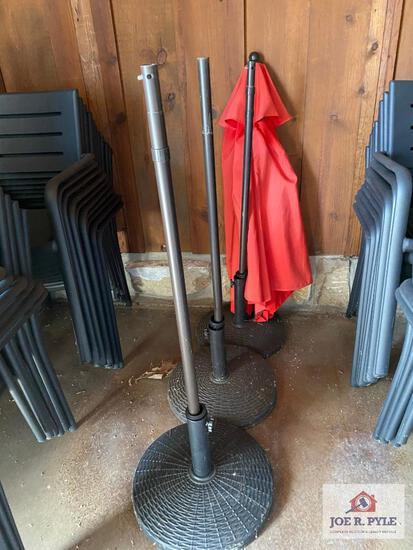 Lot 3 patio umbrella stands and 1 umbrella