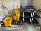 2 plastic serving carts & 2 mop buckets