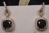 PAIR OF 14K GOLD LADIES BLACK AND WHITE DIAMOND EA
